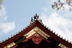Japanese temple roof against blue sky. Royalty Free Stock Photos