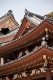 Japanese temple roof against blue sky. Stock Image