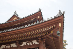Japanese temple roof against blue sky. Royalty Free Stock Photo