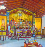 In Japanese Temple of Unawatuna. UNAWATUNA, SRI LANKA, DECEMBER 4, 2016: The prayer hall of Japanese Peace Pagoda with rich golden decorations, on December 4 in royalty free stock photos