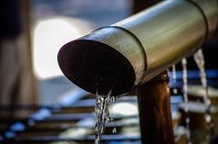 Japanese Temple Water Cleansing Fountain royalty free stock image