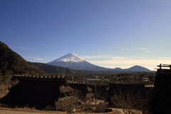 Japanese thatched roof house and Mt. Fuji Royalty Free Stock Photo