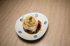 Japanese tofu, Japanese soft cold tofu. With sauce in a dish on dining table Stock Photos