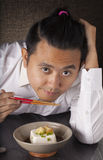 Japanese tofu. A man prepare to eat Japanese cold tofu on dining table with chopsticks Royalty Free Stock Image