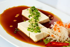 Japanese tofu soft cold with sauce in a dish Royalty Free Stock Image