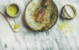 Japanese tools and bowls for brewing matcha green tea. Flat-lay of Japanese tools and bowls for brewing matcha green tea. Matcha powder in tin can, Chashaku Stock Photos