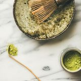 Japanese tools and bowls for brewing matcha tea, square crop. Flat-lay of Japanese tools for brewing matcha tea. Matcha powder in tin can, Chashaku spoon, Chasen Stock Images