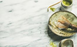 Japanese tools for brewing matcha tea, marble background, copy space. Flat-lay of Japanese tools for brewing matcha green tea. Matcha powder in tin can, Chashaku stock images