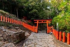 Japanese Torii and Fence. In the forest near the Kamikura temple, Kumano Kodo track, Shingu, Japan royalty free stock photography