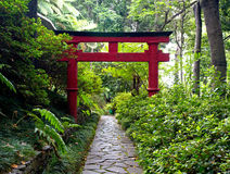 Japanese Torii gate and the stone pathway in  Zen garden Stock Photo