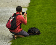 Japanese Tourist Photographer. Japanese tourist with lot of equipment makes photographs Stock Photography
