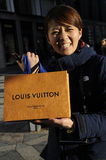JAPANESE TOURIST WITH SMALL GIFT FOR SISTER Stock Images