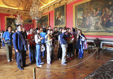 Japanese tourists. Classical picture of japanese tourists visiting a museum. picture taken in versalles palace on 17th of june and intends to show many japanese Royalty Free Stock Image