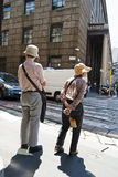 Japanese tourists. Waiting in front of a traffic light in the city of milan Royalty Free Stock Photography