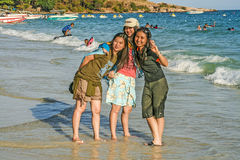 Japanese tourists pose for a selfy at the beach Stock Photos
