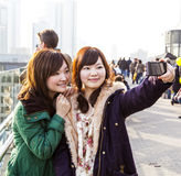 Japanese tourists take Royalty Free Stock Photos