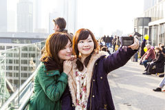 Japanese tourists take self-portraits Stock Photos