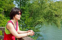 Japanese tourists walk on the banks of the Marne Royalty Free Stock Photos