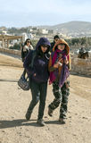 Japanese tourists walking in Petra Stock Photo
