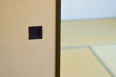 Japanese tradition house interiors with plywood partition & Tatami floor mats Royalty Free Stock Image