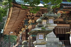 Japanese traditional architecture, Buddhist temple. Traditional Japanese architecture in Kotohira, Shikoku, Japan. Temple wooden roof and lanterns Royalty Free Stock Photography