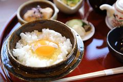 Japanese traditional food mixes a raw egg and rice. Set royalty free stock image