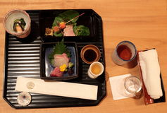 Japanese traditional Kaiseki Ryori. Traditional japanese cuisine served with meat, fish and tea Stock Photo