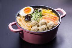 Japanese ramen noodles in soup. A japanese traditional noodles cuisine called ramen with boiled egg, braised pork in soy or pork soup Royalty Free Stock Image