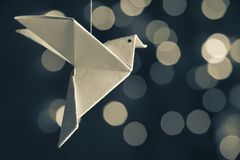 Japanese traditional origami bird in a bokeh gray-scale background stock photos