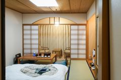 Japanese traditional room with tatami mat and shoji sliding paper door. Japanese traditional room interior with tatami mat and shoji sliding paper door royalty free stock photography