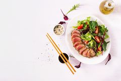 Japanese traditional salad with pieces of medium-rare grilled Ahi tuna stock photo