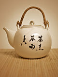 Japanese traditional tea-pot. Traditiona japanese teapot on a bamboo tablecloth royalty free stock photo