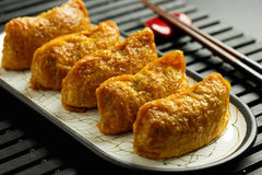 Japanese traditional type of sushi Inari-zushi. Made from fried soy wrapper and filled with sushi rice Royalty Free Stock Photo