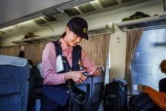 Japanese Train Conductor. TOKYO, JAPAN - NOVEMBER 23: Train Steward in Tokyo, Japan on November 22, 2013. Train steward of JR train checks for ticket and makes Royalty Free Stock Photo
