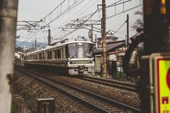A Japanese train driving by. royalty free stock images
