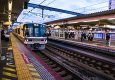 Japanese train in JR Nara Station. Japanese train moving off on a rail platform in JR Nara Station. Nara, Japan Royalty Free Stock Photography