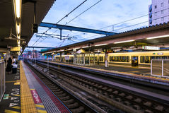 Japanese train platform JR Nara Station. Japanese railway tracks on train platform in JR Nara Station. Nara, Japan Royalty Free Stock Image
