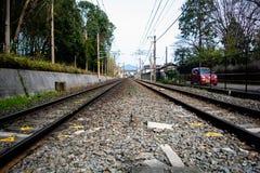 Japanese train tracks besides a freeway stock image
