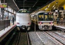 Japanese trains at JR Kyoto Station. Japanese trains: Thunderbird and Local Rapid trains at JR Kyoto Station train platform. Kyoto, Japan Royalty Free Stock Photography