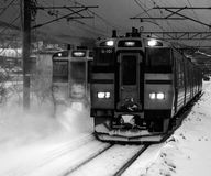 Japanese Trains in Winter. Two trains blowing snow in winter. In Hokkaido, Japan stock photography