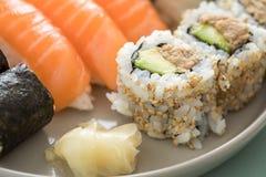 Japanese tuna avocado inside out California with salmon Nigiri and Maki on sushi mix plate stock photo