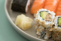 Japanese tuna avocado inside out California with salmon Nigiri and Maki on sushi mix plate stock images