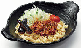 Japanese udon noodle with minced beef, onion, tomatoes and botan Stock Photo