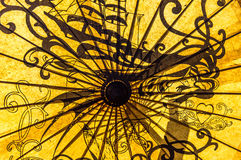Japanese Umbrella. Yellow Japanese paper umbrella with abstract design Stock Images