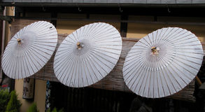 Japanese umbrellas. Three white Japanese umbrellas situated at the entrance of a traditional coffee bar in Kyoto,Japan Stock Photography