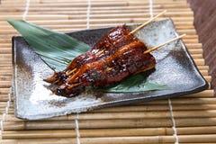 Japanese unagi (eel) Kushiyaki, Skewered and Grilled Meat Stock Image