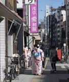Japanese urban street scene with women dressed in Kimonos. With backs to camera, Asakusa, Japan stock photos