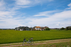 Japanese village. View on Japanese village, houses, rice field, bicycle Royalty Free Stock Photography
