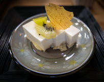 Japanese village dessert, tofu pudding. Garnished with kiwi fruit and thin tofu flake. This restaurant is in Ohara, Kyoto. Japan Royalty Free Stock Photo