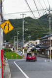 Japanese Village in Yamaguchi City, Japan. A Japanese village located under the mountain in Yamaguchi City.  The sign warns of the narrow road was on the pole Stock Photography